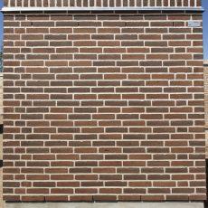 Konstruktion bygget af Strøjer tegl's: B420.Mocca Richs, fuge: Hvid/LysegrÅ