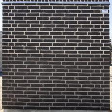 Konstruktion bygget af Strøjer tegl's: B840.Mista , fuge: LysegrÅ/Antracit